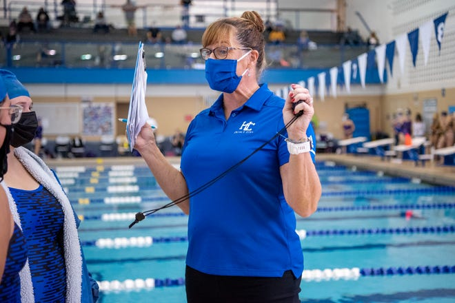 Harper Creek head swim coach Corrin Buck encourages swimmers during the All-City Girls Swim Meet on Saturday, Oct. 3, 2020 at Harper Creek High School in Battle Creek, Mich.