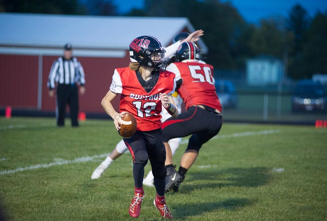 Bucyrus' Malachi Bayless rolls out of the pocket.