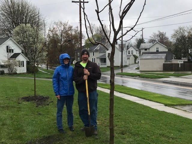 Val Spreng, who served as Bucyrus Tree Commission president last year, stands with Bucyrus maintenance worker Eric Clady just after planting a honey locust tree on Arbor Day at the Bucyrus Elementary School in 2019.