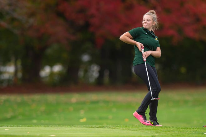 Burr and Burton's Kaylie Porter reacts to a putt from off the 18th green during the high school girls golf state championship at Champlain Country Club in Swanton on Tuesday, Oct. 6, 2020.