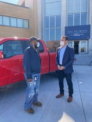 Ronald Green, left, is a 43-year Kansas City Assembly Plant worker who talked with John Savona, Ford North America Manufacturing vice president on Tuesday, October 6, 2020 after a company celebration. They're standing in front of a 2021 F-150 pre-production prototype.