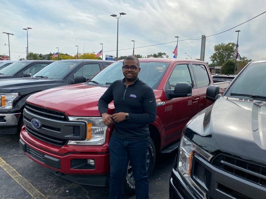 Eddie Hall III, general manager of Royal Oak Ford, is pictured here at the dealership on October 6, 2020 with 2020 F-150s.