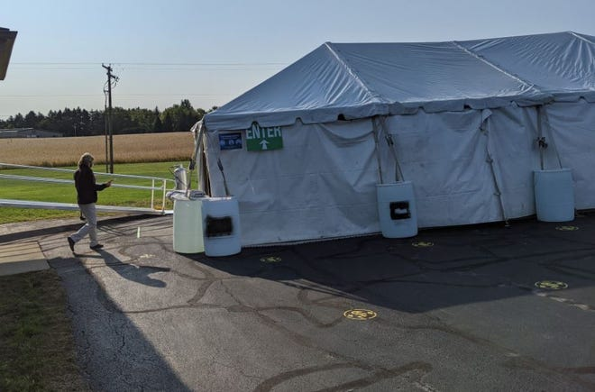 A voting tent has been pitched to help space early voters out at the Sandusky County Board of Elections.