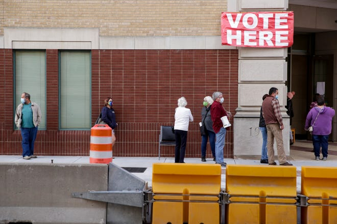 Voters line up outside the Tippecanoe County Office Building for early voting, Tuesday, Oct. 6, 2020 in Lafayette.