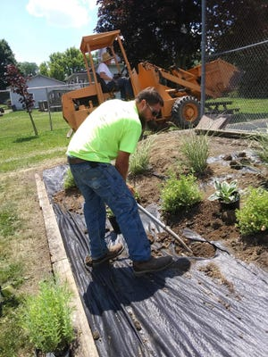 A landscaper works on a project in Shiloh. Beautification grants were awarded to mark the 75th anniversary of the Richland County Foundation.