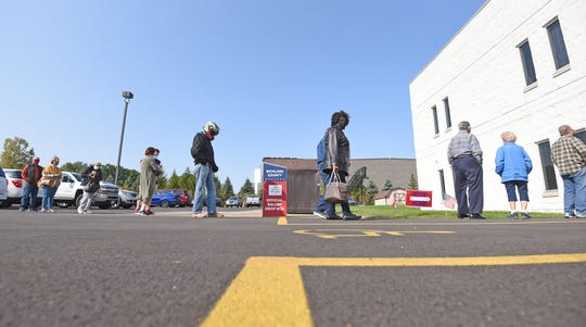 The Richland County Board of Elections was busy Tuesday morning as early voters cast their ballots.
