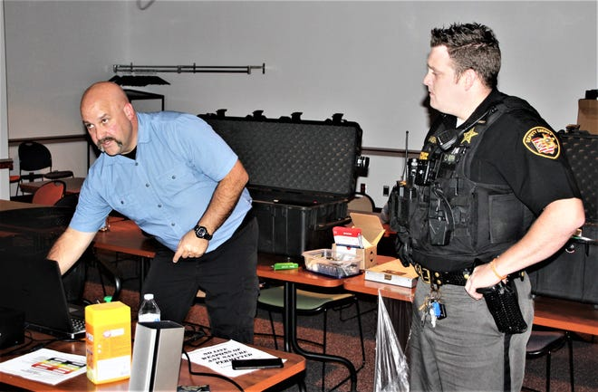 Training instructor Steve Flory, left, talks with Marion County Sheriff's Deputy Nicholas Vanbuskirk during a use of force training session on Wednesday, Sept. 30, 2020, at the sheriff's office. The training is provided for the sheriff's office at no cost through the County Risk Sharing Authority.