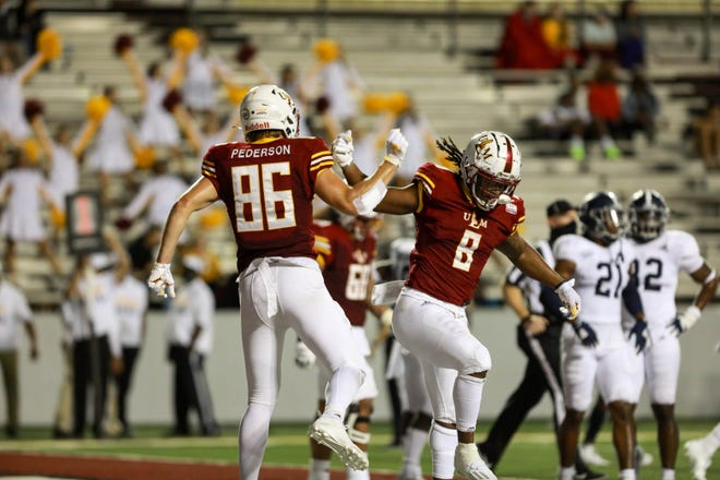 Running back Josh Johnson (8) celebrates with tight end Josh Pederson (86) following one of his three touchdowns in ULM's 35-30 loss to Georgia Southern at Malone Stadium. Johnson ran for two scores and caught another.