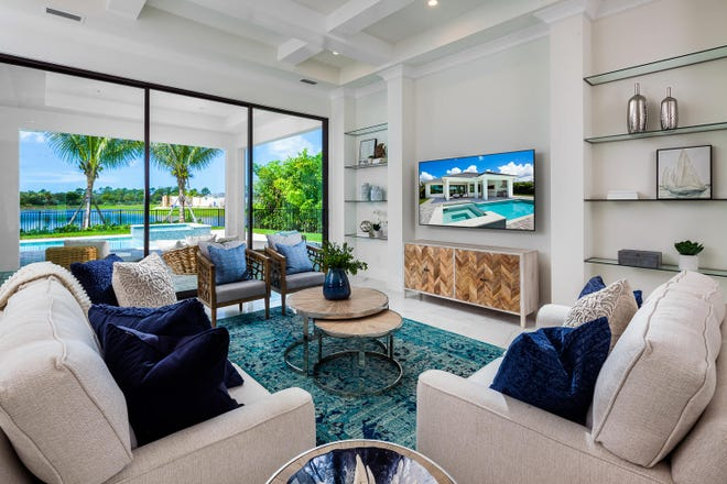 Open floor plans designed specifically to take in the lake and golf course views, are offered by Imperial Homes of Naples in Peninsula at Treviso Bay.