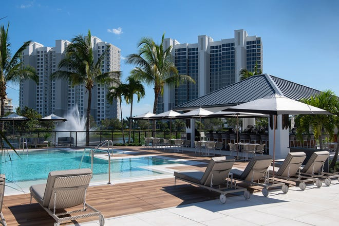 A limited number of luxury residences are available for immediate occupancy in Kalea Bay's spectacular second tower (right).