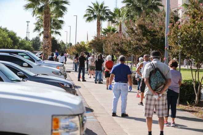 The line for early voting wraps around the Doña Ana County Government Center in Las Cruces on Tuesday, Oct. 6, 2020.