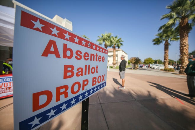 An absentee ballot drop box is placed in front of the Doña Ana County Government Center in Las Cruces on Tuesday, Oct. 6, 2020.