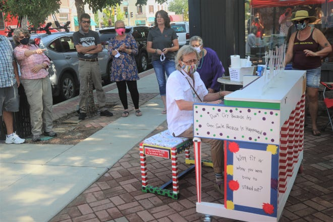 Hoyle Osborne plays a ragtime tune in Aztec's Main Avenue Plaza on Aug. 15, 2020, during the introductory event for the town's Painted Pianos -- Big Sound in a Small Town project. A season finale celebration for the project will take place Oct. 11 in downtown Aztec, along with an antique car show.