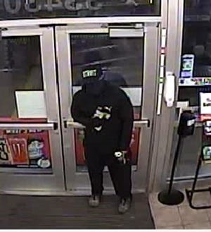 Security camera footage from a Speedway gas station in Farmington Hills shows this armed robbery suspect.