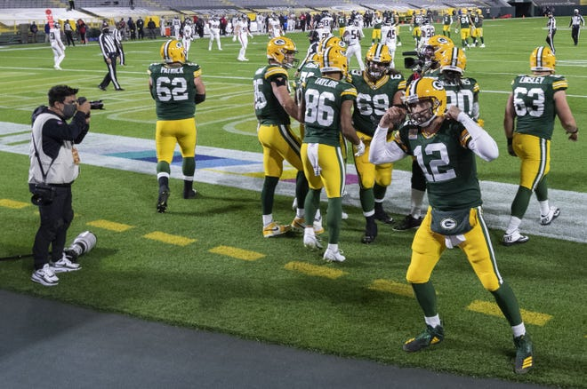 Green Bay Packers quarterback Aaron Rodgers (12) mugs for a television camera after throwing a touchdown pass to tight end Robert Tonyan during the second quarter of their game against the Atlanta Falcons Monday, October 5, 2020 at Lambeau Field in Green Bay, Wis.