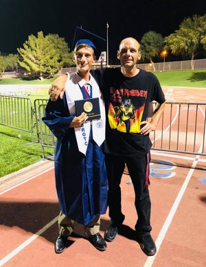 """Thomas """"Tommy"""" Teague of La Quinta is shown with his son, Nathan """"Nate"""" Choate at his graduation from La Quinta High School in 2018. Teague was found dead by sheriff's search and rescue teams Sunday afternoon, October 4, 2020, off a trail in the La Quinta Cove area."""