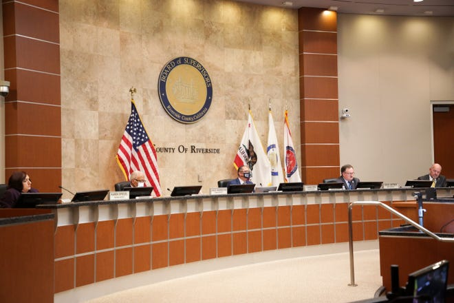 Supervisors listen as public comment takes place at a Riverside County Board of Supervisors meeting regarding plans to reopen the county during the COVID-19 pandemic on Tuesday, October 6, 2020, in Riverside, Calif.