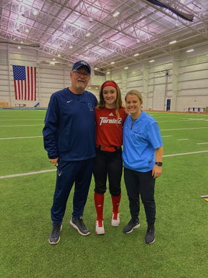 Armada softball player Sydney Elliott verbally committed to Northwood University on Wednesday, Sept. 30, 2020. Pictured is Elliott with northwood coach Gregg Elliott and assistant Brittney Horan.