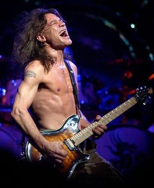 Van Halen guitarist Eddie Van Halen performs in 2004 in Phoenix. Van Halen, who had battled mouth cancer, died Tuesday. He was 65.