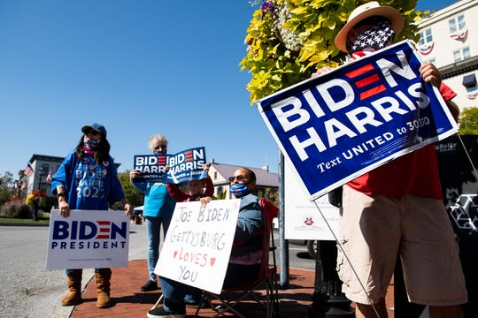Around a dozen people gathered in Gettysburg's Lincoln Square to show their support for Democratic presidential nominee Joe Biden on Tuesday, hours before the former vice president was scheduled to make a visit to the area later in the day.