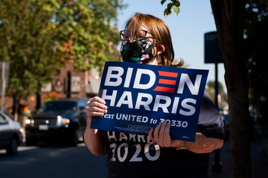 Helen Cook, of East Berlin, Pa., holds a sign and chants in support of Democratic presidential nominee Joe Biden in Gettysburg's Lincoln Square on Oct. 6.