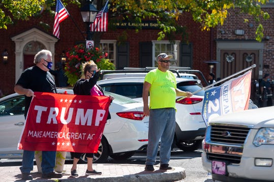 A group of people show their support for President Donald Trump in Gettysburg's Lincoln Square on Tuesday, October 6, 2020.