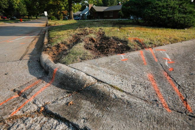 Dirt is disturbed and markings can be seen on the street at the intersection of Bennett Street and Fairway Avenue where police investigated the scene of a fatal crash on Monday night.