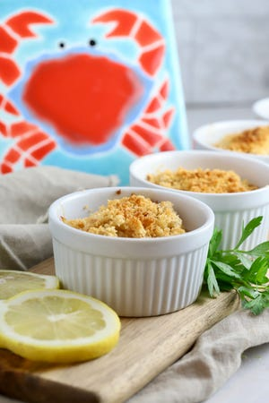 A few buttery, crushed crackers hold everything together in Deviled Crab.