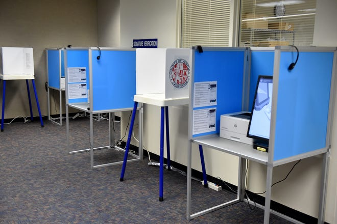 Traditional and electronic voting booths are ready for voters at the Elections Division of the Ventura County Government Center on Tuesday, October 6, 2020 as election month begins.
