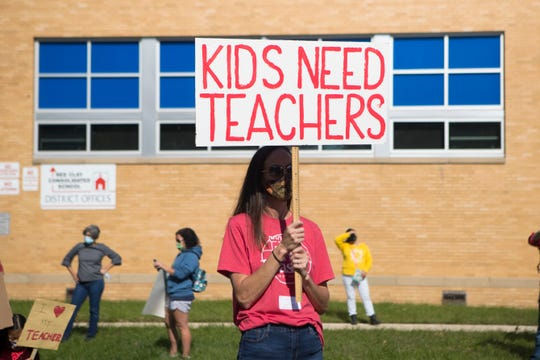 Approximately 30 Red Clay parents and teachers protest a move that would give remote students less time with teachers Tuesday, Oct. 6, 2020, in front of the Red Clay District Offices.