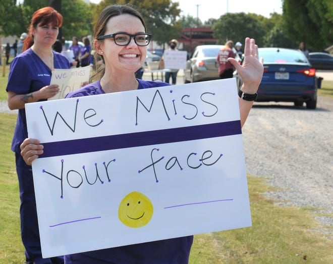 In this file photo, Hospice of Wichita Falls director of social services, Courtney Galloway greets volunteers during a volunteer appreciation drive-thru lunch. Hospice will hold an in-person volunteer training for first time since COVID-19.