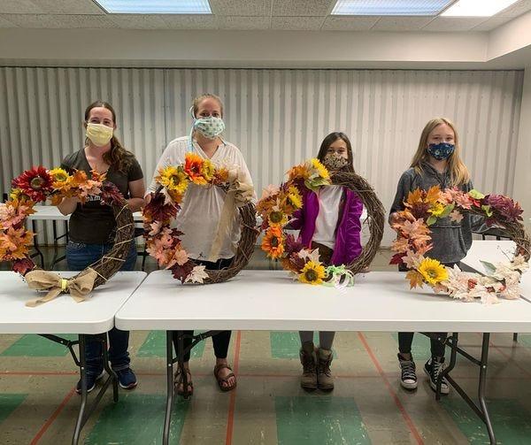 Chippewa County 4-H members put together fall wreaths.