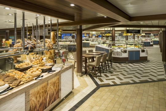 A view of the Windjammer buffet area on Royal Caribbean's Oasis of the Seas. The cruise lines still plans to offer buffets but says they will no longer be self-service.