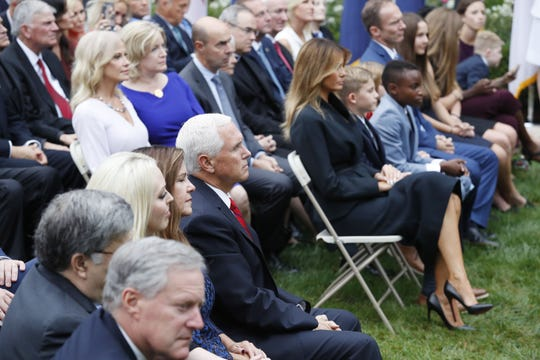 Vice President Mike Pence and Karen Pence sitting directly across from first lady Melania Trump, with former White House senior adviser Kellyanne Conway right behind her, in the Rose Garden on Sept. 26, 2020. Next to the first lady is the family of Supreme Court nominee Amy Coney Barrett.