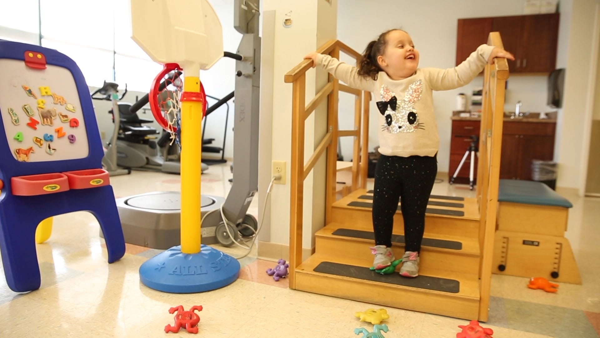 Little girl with spina bifida walks on her own
