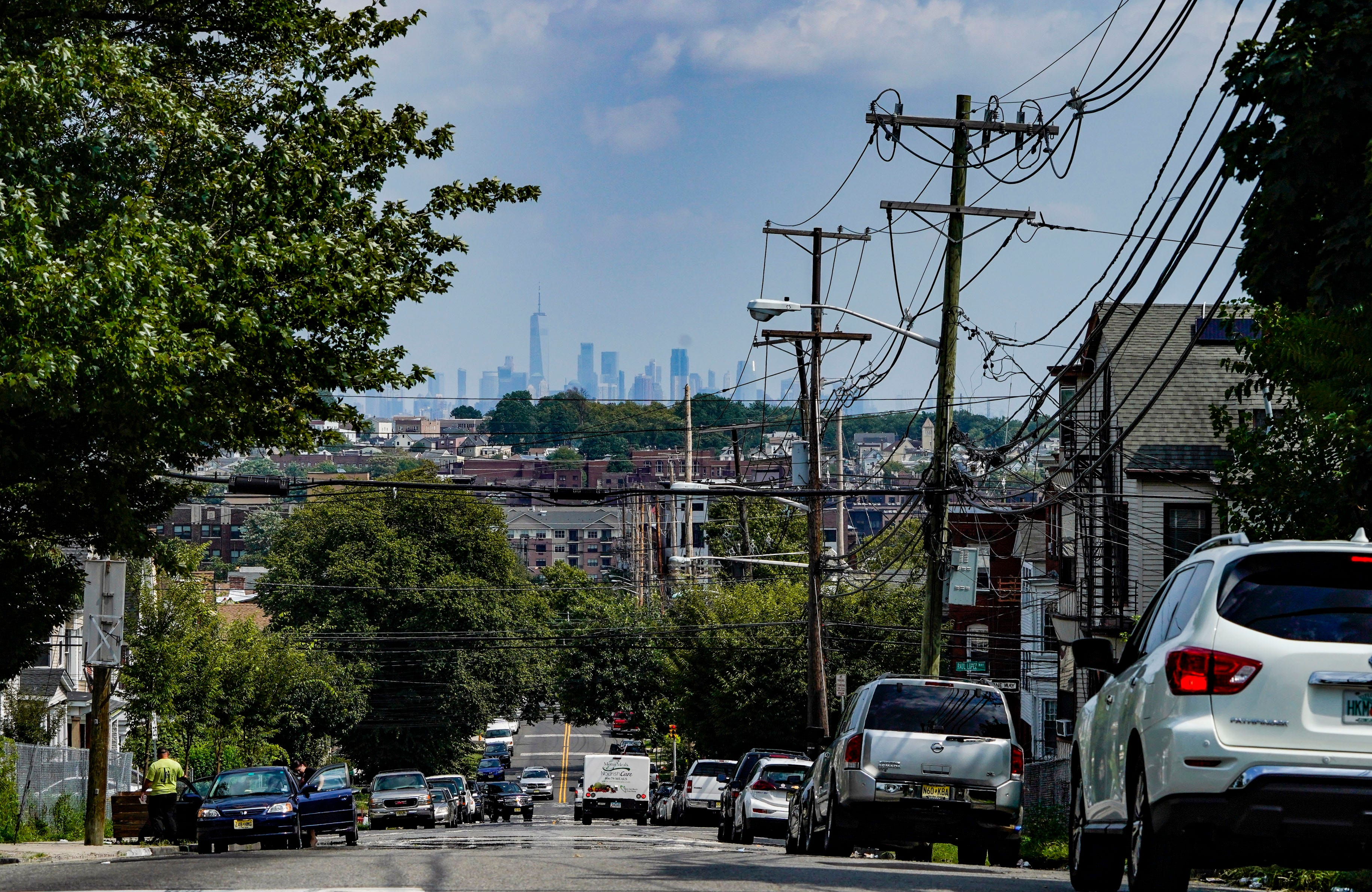 The New York City skyline seen from a neighborhood in East Orange, N.J. In Essex County, the communities with the highest cases of COVID-19 are populated by more Black and brown people than by white Americans.