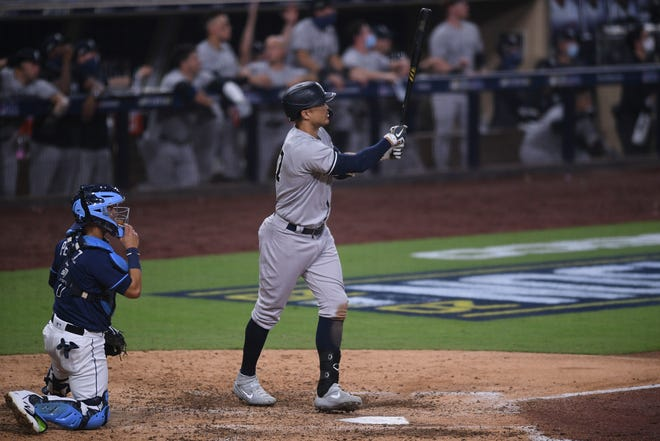Rays-Yankees, ALDS Game 1: Yankees designated hitter Giancarlo Stanton hits a grand slam in the ninth inning.