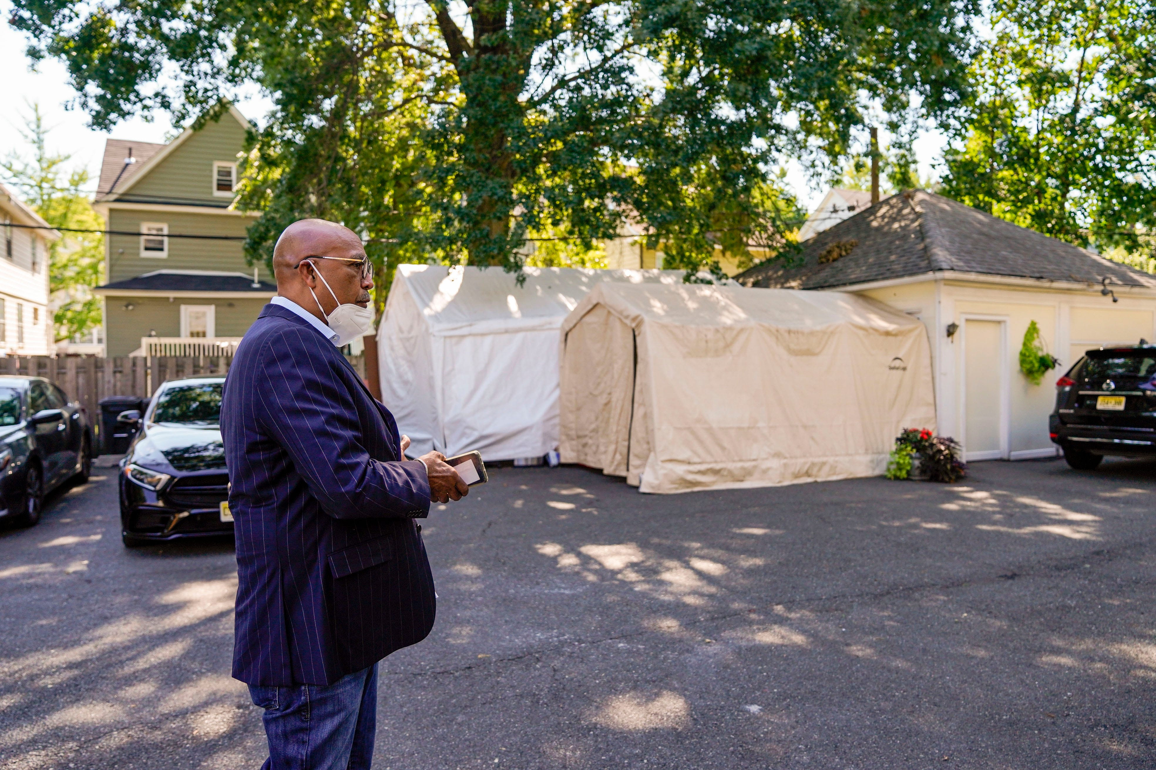 """""""I knew I needed to help these families,"""" said John B. Houston outside Cushnie-Houston Funeral home in East Orange, N.J., one of three funeral homes he directs. """"This is my calling. What I'm supposed to do. It's not easy."""""""
