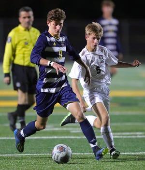 Bryson Pozniak, right, is a senior for the Aurora boys soccer team this season.