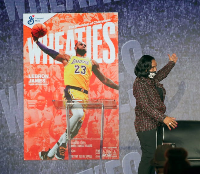 Gloria James unveils the Wheaties cereal box with her son LeBron's image Wednesday during The I Promise Huddle in Fairlawn.