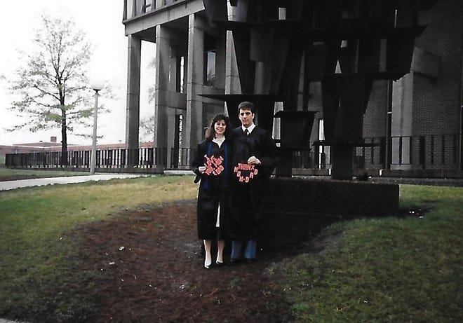 Craig Webb and his soon-to-be wife, Jennifer, take a graduation day picture at Kent State in 1990.