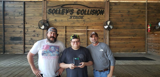 Mill Street Tavern owners David Wood (left) and Tim Dighton (right), and employee Scotty Hacker recently received the Employer of the Year award from the Oklahoma Association of People Supporting Employment First, an organization dedicated to helping those with developmental disabilities find employment.
