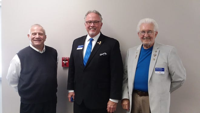 Posing, from left, are New London Rotary President Ted Buehl, District 6600 Governor Keith Hodkinson, Assistant Governor Bob Buskey during the New London Rotary Club's meeting Monday.