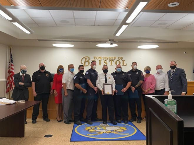 Deputy Fire Chief Brian Gerhard and firefighters Thomas Stressman, Todd Dipopolo and Daniel Matthews were honored for the rescue of a township woman from her burning home.