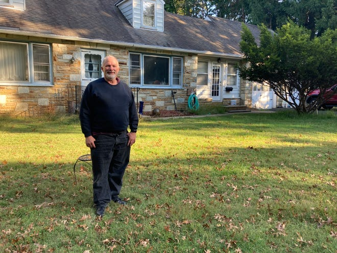 Chris Mendla of Upper Southampton, in front of his house. Months after filing for unemployment, he still awaits his checks.