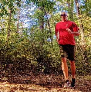 Bob Kaehler, the most decorated heavyweight rower in U.S. history, runs the trails of Tyler State Park on a regular basis.