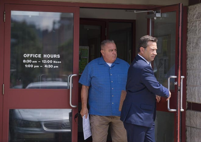 The long-delayed jury trial of suspended Ambridge Police Chief James Mann, shown at left leaving a district judge's office with his attorney in 2018, continues this week as Mann faces 10 charges, including seven counts of theft by deception. [BCT file]