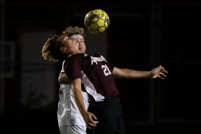 Ambridge's Tyler Simms, right,  blocks Freedom's Jay Hessler as they go up for the ball at the same time.