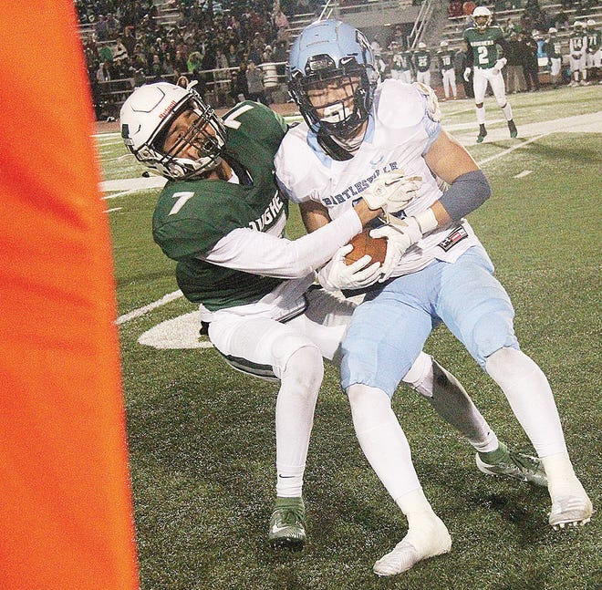 Bartlesville High receiver Caden Davis, left, struggles to get past the first-down marker while a Muskogee player defends during the 2019 football meeting in Muskogee.