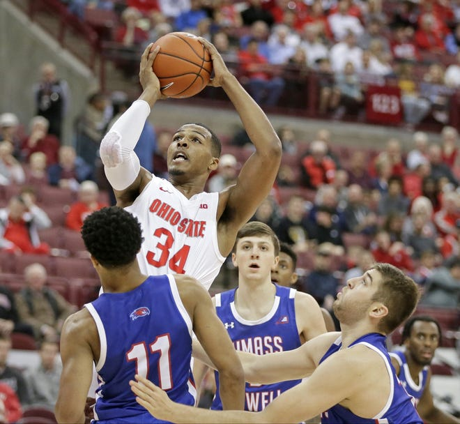 Ohio State Buckeyes forward Kaleb Wesson (34) is guarded by UMass Lowell River Hawks guard Obadiah Noel (11) and guard Josh Gantz (12) during the first half of Sunday's NCAA basketball game at Value City Arena in Columbus on November 10, 2019. Ohio State won the game 76-56. [Barbara J. Perenic/Dispatch]